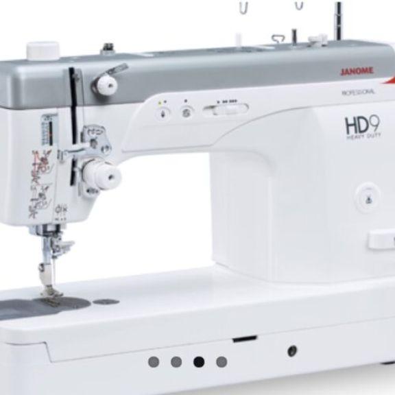 Maquina de coser profesional janome HD9